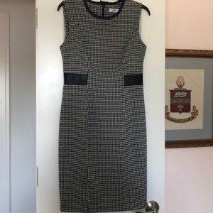 Houndstooth dress with faux leather trim